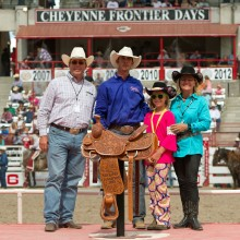 The Orman family with RAM trucks presented Jojo his trophy saddle for winning the all-around title at Cheyenne Frontier Days.
